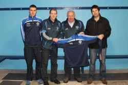 Receiving the club tops from Mike Morley. Brian Crowley, Timmy Clifford, Mike Morley and Tommy Granville.